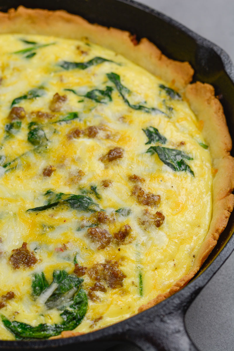 This Sausage and Spinach Quiche is the perfect easy brunch recipe that is deceptively impressive! With options for low carb, keto and gluten free diets this recipe is perfect for everyone!