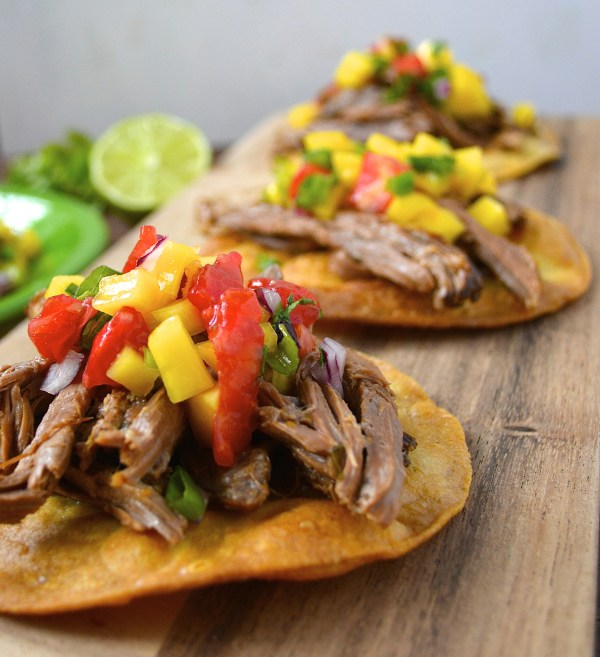 Slow Cooker Shredded Habanero Beef Tostadas are topped with fresh Mango Salsa! Delicious, easy and totally different!