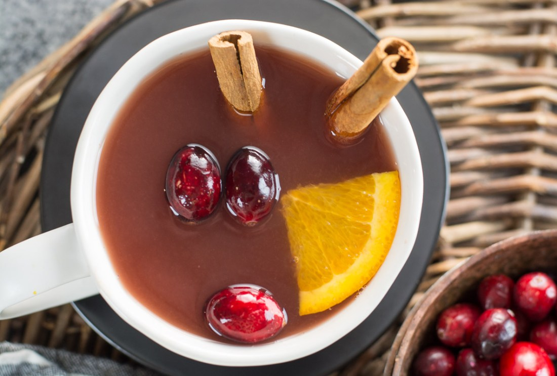 This Cranberry Pineapple Tea is full of mulled spices like cinnamon and cloves along with fresh fruit. This festive tea is essential for holiday entertaining!