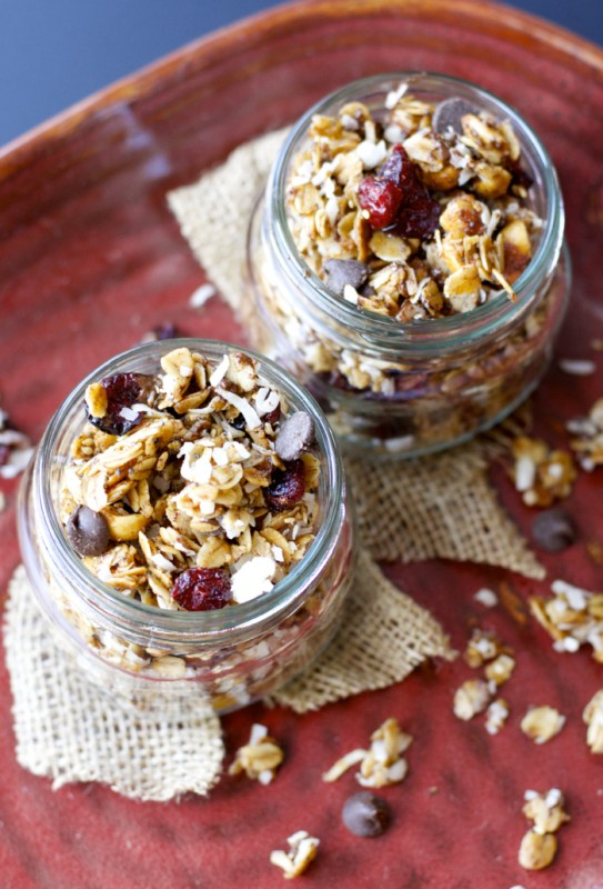 This loaded granola is packed with rich dark chocolate, tart cranberries, cinnamon coconut, nuts, and seeds! It is the perfect grab and go snack for any occasion!