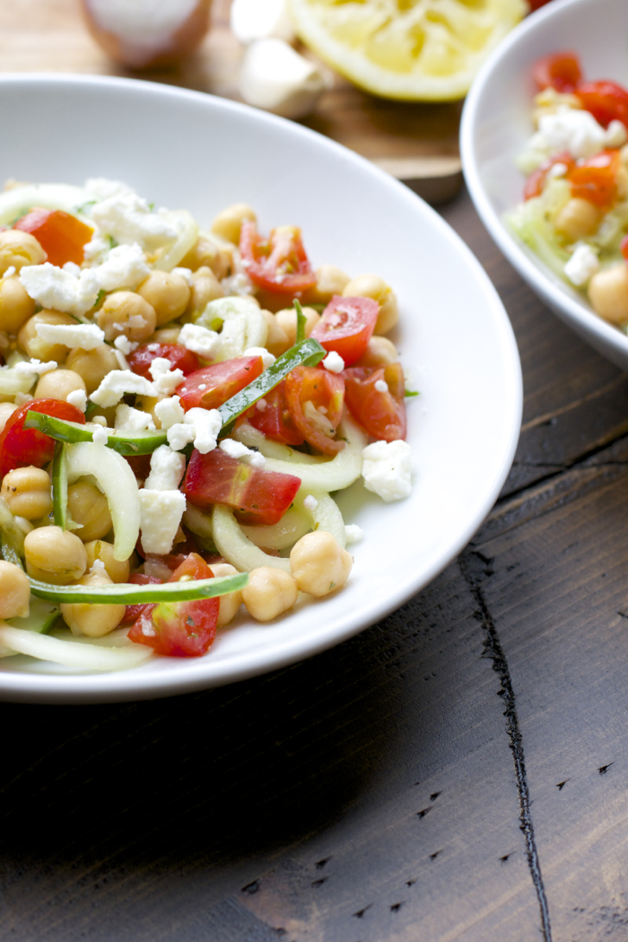 This Cucumber Chickpea Salad is packed with spiralized cucumbers, cherry tomatoes, chickpeas, feta and tossed in a simple lemon vinaigrette.