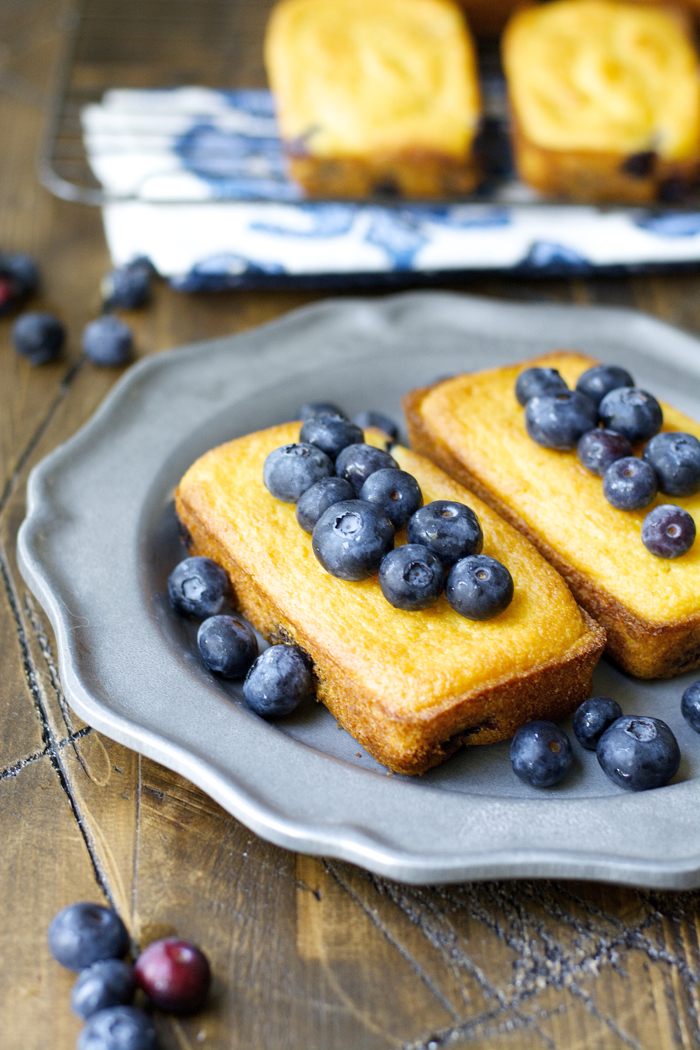 Blueberry Cornmeal Bread Sweet mini cornmeal loaves are packed with fresh blueberries and vanilla for a perfect Summer combination!