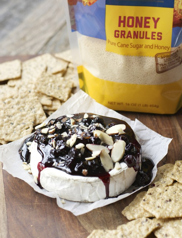 Honey Almond Baked Brie! This easy appetizer is packed with sweet flavor met by the savory brie! It is an unstoppable sweet and savory combo!