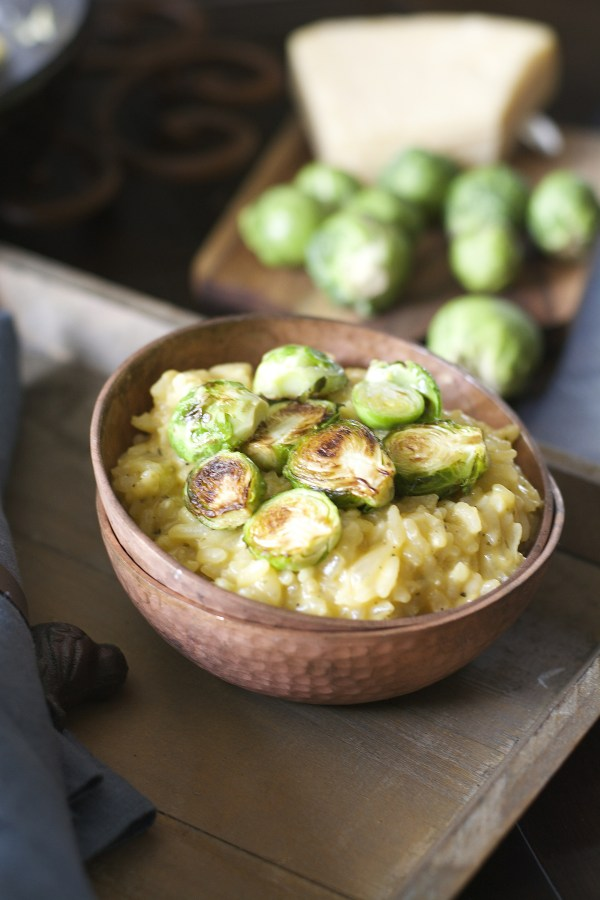 Crispy pan seared Brussels Sprouts are laid atop a bed of creamy Parmesan and white wine risotto! An ultra comforting Winter dish!