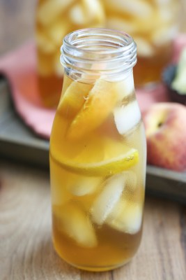 Sweet and refreshing Vanilla Peach Tea is the perfect Summer drink! Serve with fresh peach and lemon slices for simple Summer entertaining!