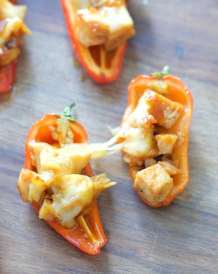 This simple six ingredient dish is perfect for Summer entertaining! Your guests will love these sweet and spicy Honey Chipotle Chicken and Gouda Stuffed Sweet Peppers!