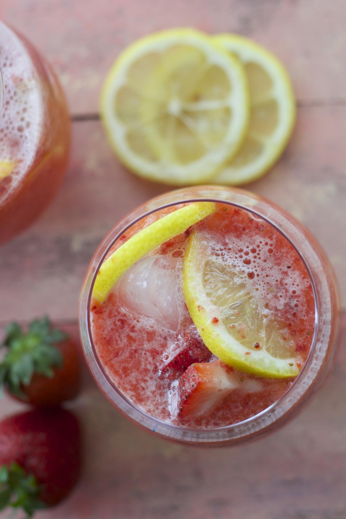 overhead view of a glass of homemade strawberry lemonade