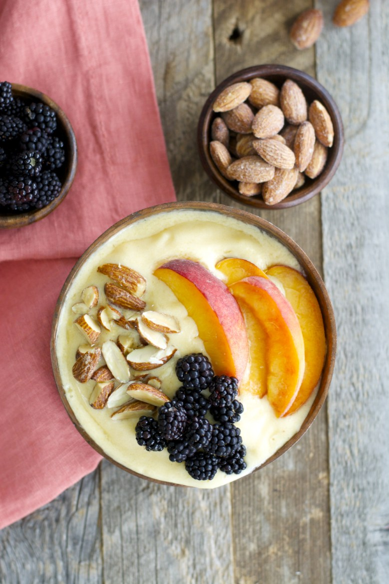 Sweet peaches, almond milk and a touch of vanilla and honey are blended until smooth and topped with crunchy granola for a hearty healthy breakfast! This easy Peaches and Cream Smoothie Bowl will be a new favorite!