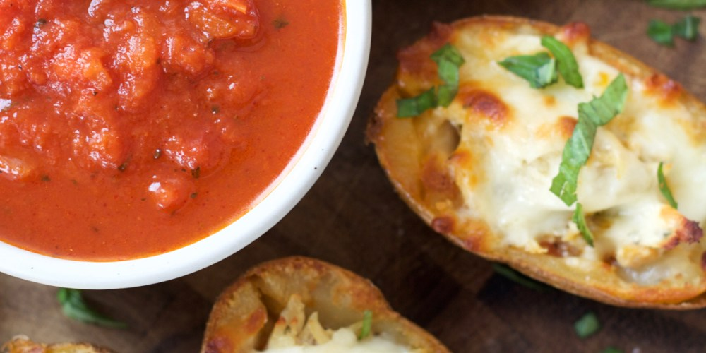 You can make these Chicken Parmesan Stuffed Potato Skins with just five simple ingredients! This easy recipe will become a family favorite!
