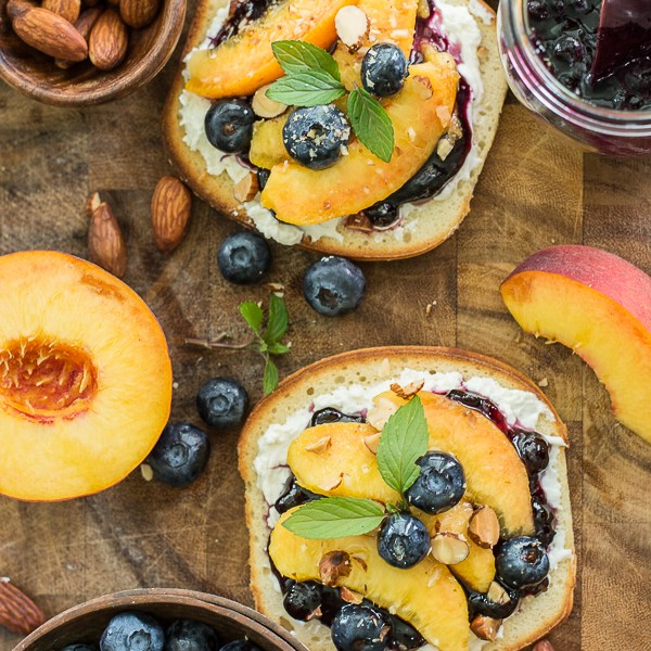This simple Sweet Peach Bruschetta combines the best flavors of Summer! Fresh peaches, blueberries and mint make for an impressive combination!