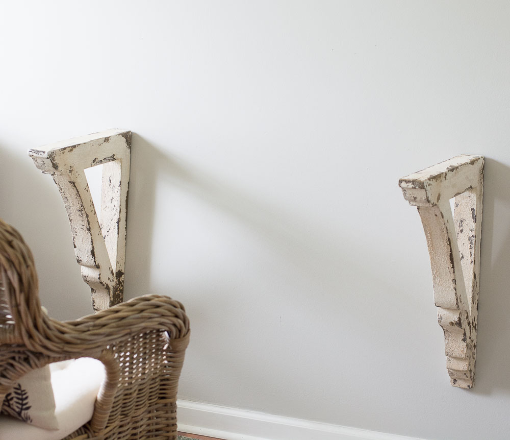 This super easy DIY Corbel Table adds a ton of farmhouse charm to any space! See how you can easily create this look in three simple steps!