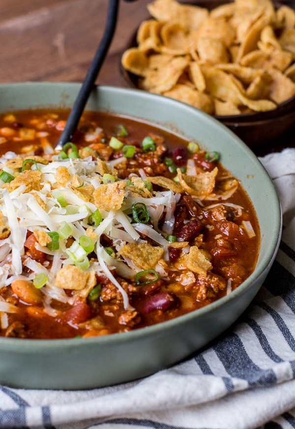 This is the Best Turkey Chili recipe! Browned turkey, two kinds of beans, tomatoes and spices make this an easy dinner you will love! Slow cooker option also!