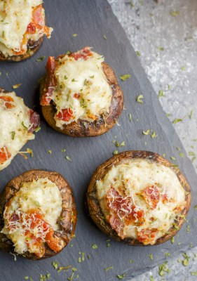 These Crab and Bacon Stuffed Mushrooms are packed with creamy cheese, salty bacon and lumps of crab meat. The perfect low carb, keto, five ingredient appetizer!
