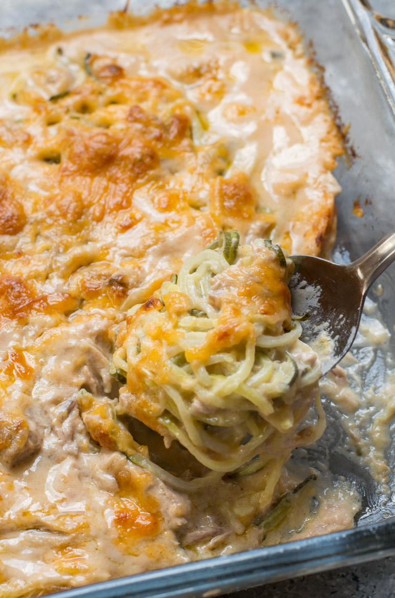 cheesy keto tuna casserole being spooned out of a glass baking dish