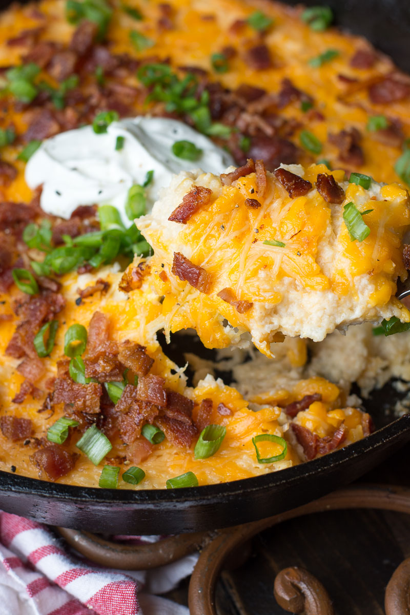 If you need a cheesy low carb side this Loaded Bacon Cheddar Cauliflower Casserole is packed with everything you love in a baked potato! At under 8 net carbs this is the perfect holiday keto side dish! #keto