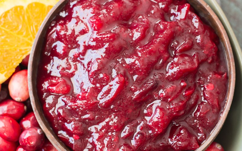 This easy three ingredient Low Carb Cranberry sauce is essential for your keto holiday spread! Learn how to make small batch, large batch and three different flavors with this easy guide. #keto