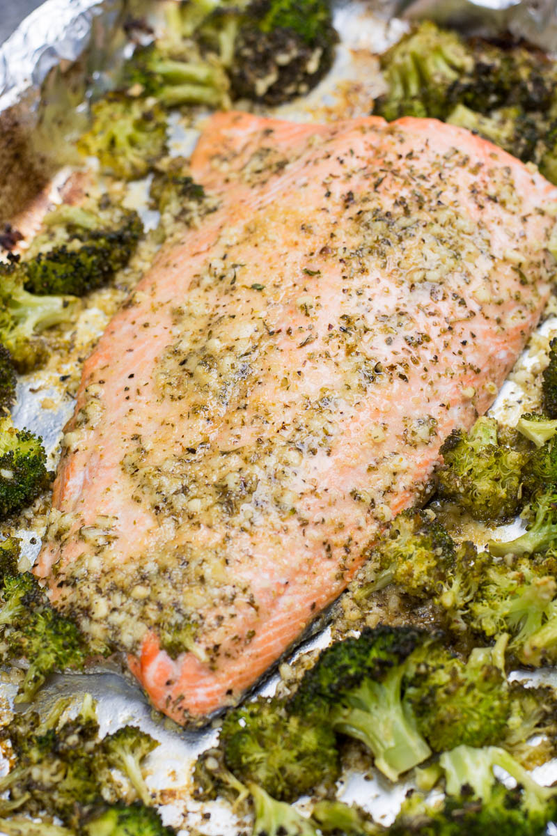 This easy Keto Garlic Butter Salmon and Broccoli Sheet Pan Dinner  is ready in 20 minutes. Packed with heart healthy fat and flavor this dish only has 5 net carbs per serving!