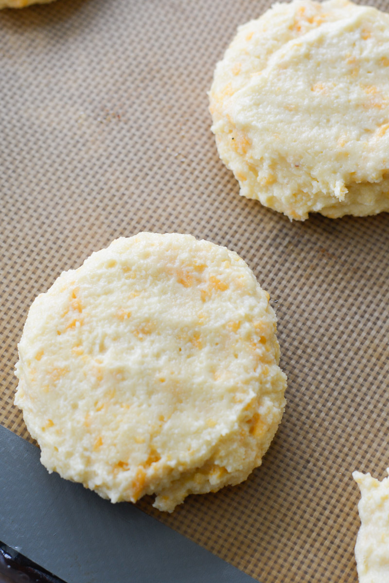 Try this Keto Sausage and Biscuit Recipe for an easy low carb breakfast! These Keto Almond Flour Biscuits are stuffed with cooked sausage patties for a high protein low carb breakfast!
