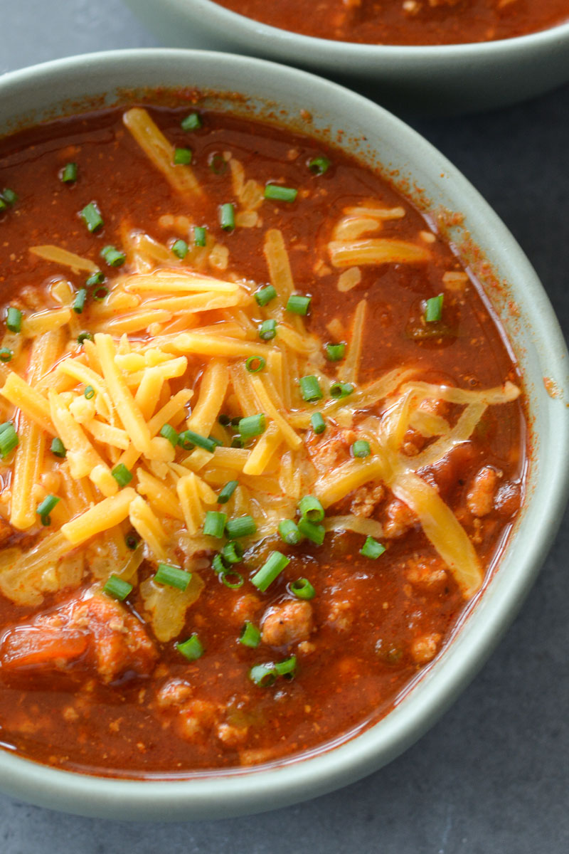 This Instant Pot No Bean Chili is loaded with ground beef, tomatoes and spices! This keto-friendly chili recipe has just 15 minutes cooking time and about 8 net carbs per serving!