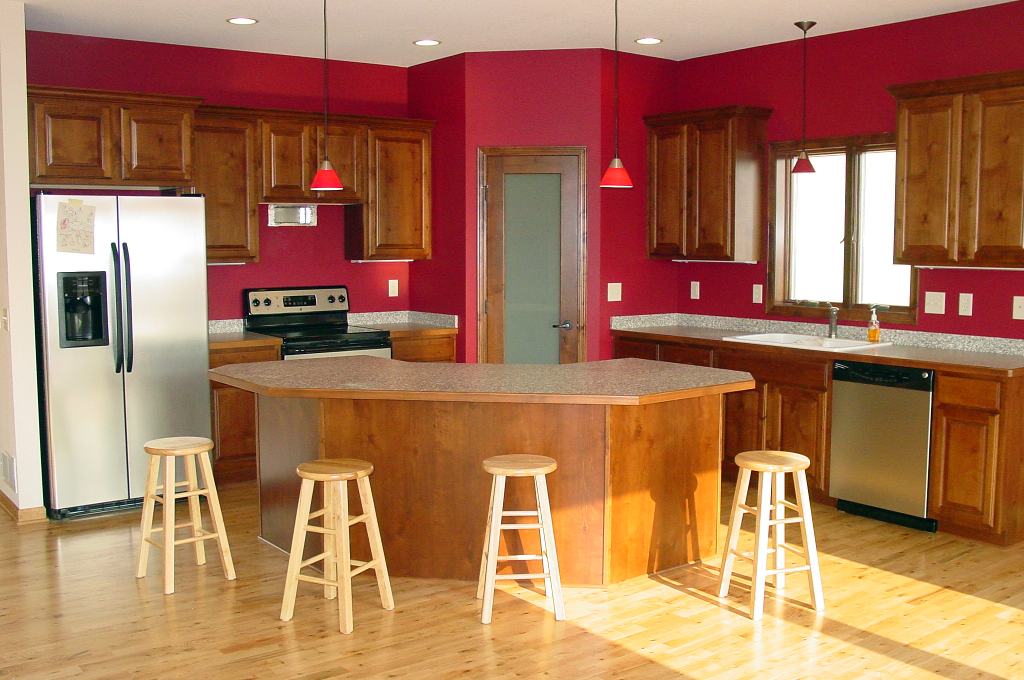 kitchen wood cabinets stainless steel stools kitchens maetzold homes inc red with and curved island