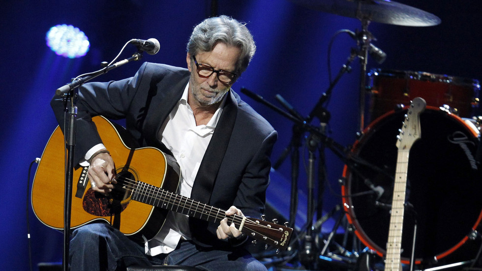 Eric Clapton attacked for revealing his own Covid-19 vaccine side effects, concerns for kids