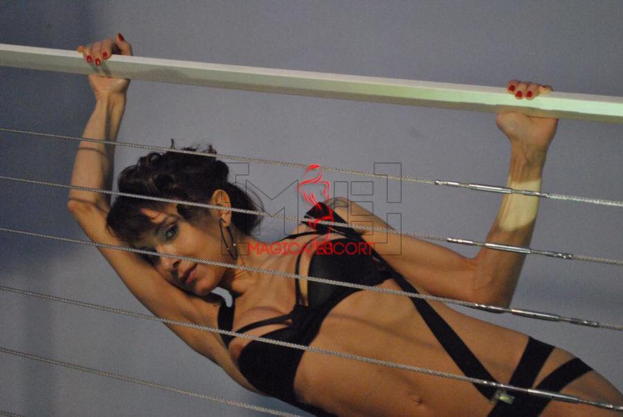 Celine top class escort Bergamo in una foto dove l'espressione è dolce ma allo stesso tempo sensuale ed invitante.