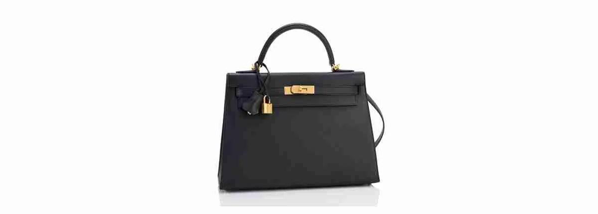 Hermès Kelly Bag black. Magica Escort
