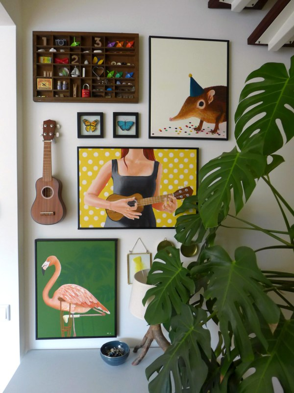 Whimsical Art Wall With Pantings Ukulele And