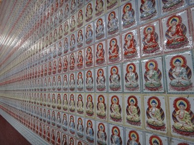 A wall of Buddhas in a Cameron Highland Temple