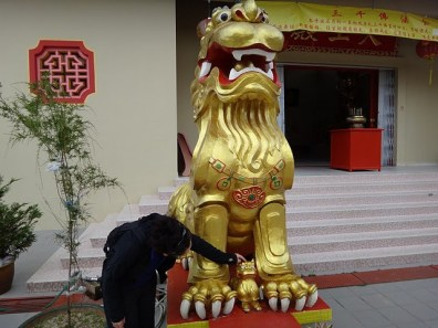 Tanya Patting a Mythical Temple Guardian