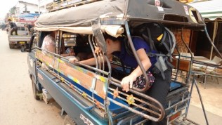 Jumping into the taxi, ok truck, to take us to our long boat cruise
