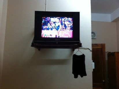 Phonsavan - Watching Australian Rules Football While The Washing Dries