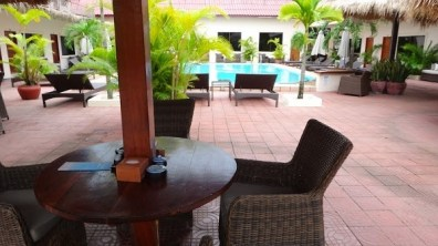 Beach Club Resort Sihanoukville - Digital Nomad Friendly Working Location - Round Covered Table With Power By The Pool Side