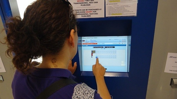 Buying Bus Tickets Via The English Touch Screen Machines at Bandar Tasik Selatan Station