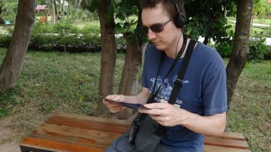 Andrew Listening To the Audio Guide At The Killing Fields, Phnom Penh, Cambodia