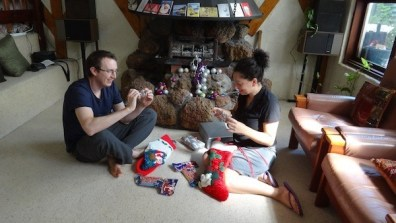 Tanya and Andrew with stockings Christmas 2012