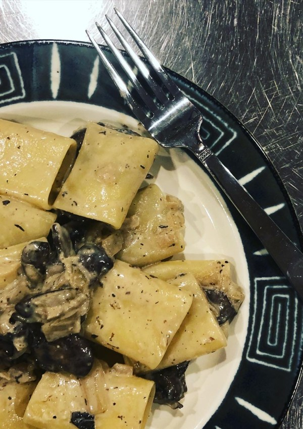 Paccheri with mushrooms, goat's milk, and thyme.