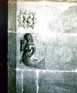 Mermaid with comb on Clonfert Cathedral, Ireland.