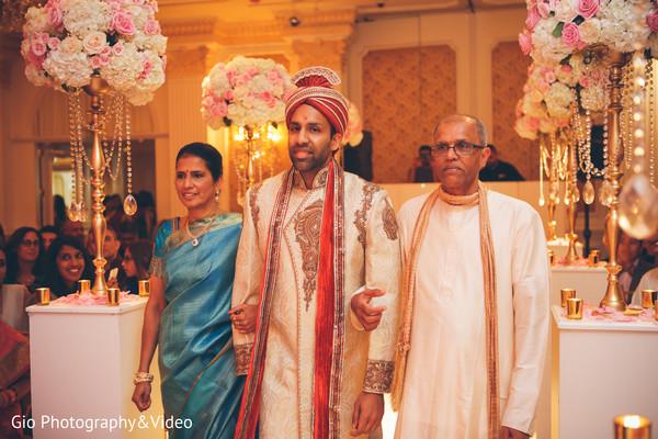 indian wedding,ceremony,indian wedding ceremony,indian ceremony,aisle decor,floral arrangements,groom fashion