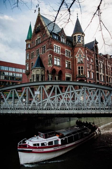 Boat under the bridge in Speicherstadt