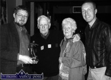 Patrick O'Keeffe Traditional Music Festival founder member and broadcaster, Peter Browne (left) presents Paddy Cronin with the festival award for a lifetime of dedication to the music of Sliabh Luachra during the Patrick O'Keeffe Traditional Music Festival in Castleisland in 2004. Included are: Mr. Cronin's wife, Connie and festival chairman, Cormac O'Mahony. ©Photograph: John Reidy 23/10/2004