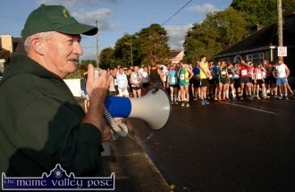 Announcer and starter, James O'Leary about to set the runners on their way at the at the start of An Riocht AC Couch-to-5K Road Race/Fun Run in Castleisland on Friday evening. ©Photograph: John Reidy