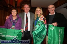 Siobhán Fleming wraps the 'Flaming Flag' around her on her arrival at the River Island Hotel in Castleisland for a reception in her honour on Monday night. With her are her parents, Joan and Jimmy (right) and neighbour Michael O'Shea, Castleisland RFC who organised the reception. ©Photograph: John Reidy 18-3-2013