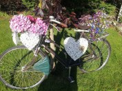 ...and the flower bedecked bicycle made for one.