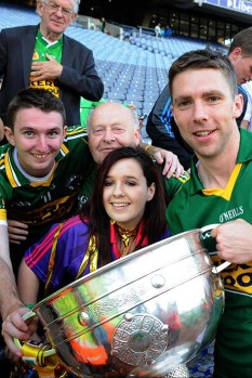 Marc Ó Sé celebrates with Tom O'Donoghue from Ballymacelligott and friends after winning the All-Ireland Football Final against Donegal in Croke Park 2014. ©Photo: Don MacMonagle
