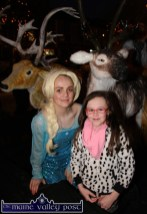 Zara O'Connor pictured in the Crag Cave 'Frozen' set with 'Elsa' aka Katie Sugrue during the Santa / Christmas Lights launch on Castleisland's Main Street on Friday evening. ©Photograph: John Reidy