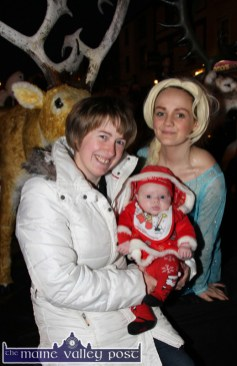 Noreen O'Brien pictured with her 11-week-old baby, Laura Curtin on her first Christmas outing with Katie Sugrue as 'Elsa' on the Crag Cave 'Frozen' set on Main Street on Friday evening. ©Photograph: John Reidy