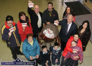 The winning line-up after Browne's Agri 2014 Draw at the store on Friday. Front row from left: Eileen Lynch, Castleisland; Oran, Rian, Caoimhe and Martina O'Neill, Killarney. Back row: Mossie O'Leary, Lyreacrompane; Marie Burke, Castleisland; John Daly, manager Browne's Agri; Séamus Murphy, overall prize-winner; Mary O'Sullivan, Browne's Agri; Vincent Murphy, P.C. and Teresa Walker, marketing manager, Lee Strand. ©Photograph: John Reidy