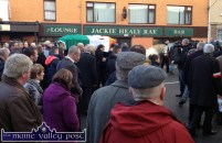 The funeral cortege halts outside the famous Jackie Healy Rae Bar and Lounge in Kilgarvan this afternoon. ©Photograph: John Reidy 8-12-2014