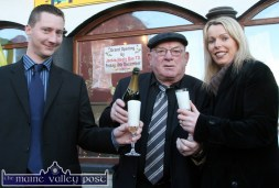 South Kerry TD, Jackie Healy-Rae pours the champagne for florist, Sheila Costello-Ring and her husband, Ted Ring after he had officiated at Market Cross on Friday just afternoon. ©Photograph: John Reidy 8-12- 2006